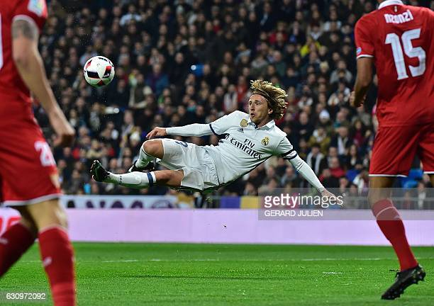 TOPSHOT Real Madrid's Croatian midfielder Luka Modric kicks a ball during the Spanish Copa del Rey round of 16 first leg football match Real Madrid...