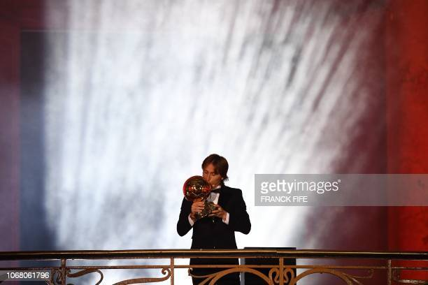 Real Madrid's Croatian midfielder Luka Modric kisses the trophy after receiving the 2018 Men's Ballon d'Or award for best player of the year during...