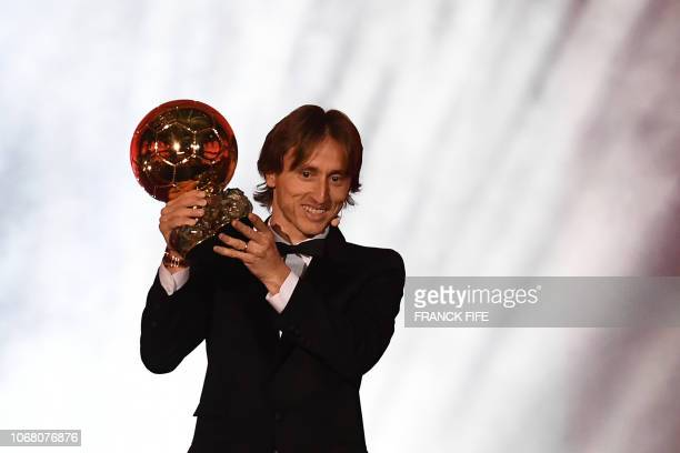 TOPSHOT Real Madrid's Croatian midfielder Luka Modric kisses the trophy after receiving the 2018 Men's Ballon d'Or award for best player of the year...