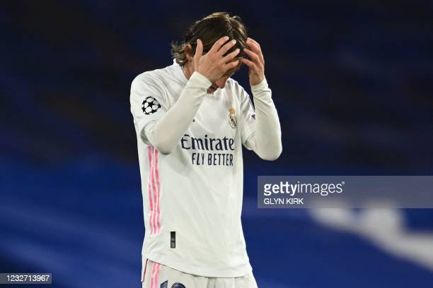 Real Madrid's Croatian midfielder Luka Modric reacts after conceding a second goal during the UEFA Champions League second leg semi-final football...