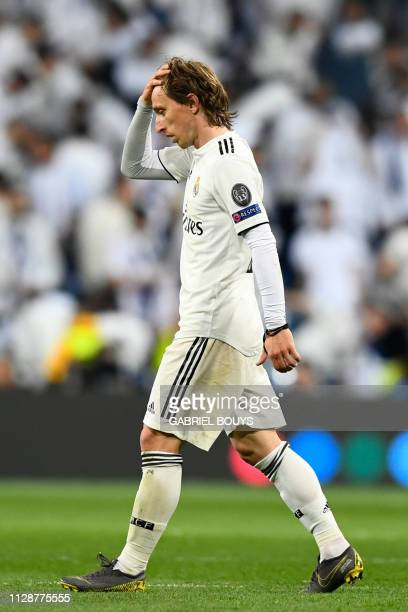 Real Madrid's Croatian midfielder Luka Modric reacts as he walks off the pitch at halftime during the UEFA Champions League round of 16 second leg...
