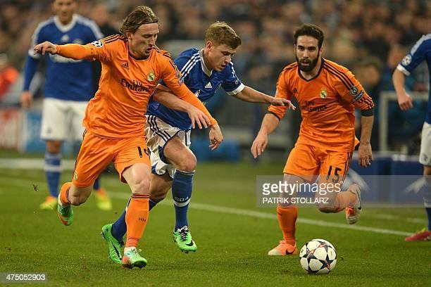 Real Madrid's Croatian midfielder Luka Modric Real Madrid's defender Daniel Carvajal and Schalke's midfielder Max Meyer vie during the firstleg round...