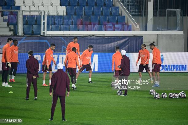 Real Madrid's Croatian midfielder Luka Modric , Real Madrid's French defender Raphael Varane and teammates take part in a training session on...