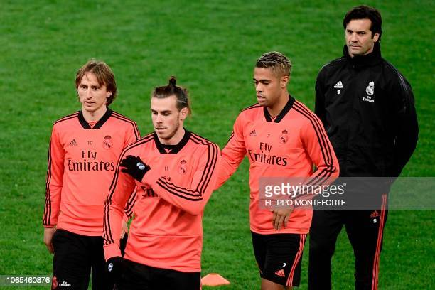Real Madrid's Croatian midfielder Luka Modric Real Madrid's Welsh forward Gareth Bale Real Madrid's SpanishDominican forward Mariano and Real...