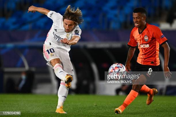 Real Madrid's Croatian midfielder Luka Modric scores a goal past Shakhtar Donetsk's Brazilian midfielder Marcos Antonio during the UEFA Champions...