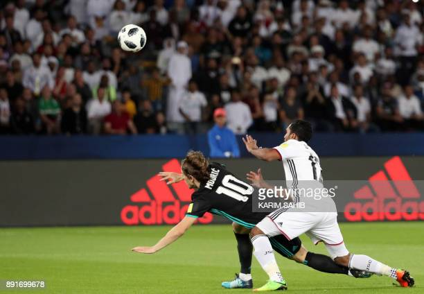 Real Madrid's Croatian midfielder Luka Modric vies for the ball with alJazira's Emirati defender Salem Rashid during the FIFA Club World Cup...