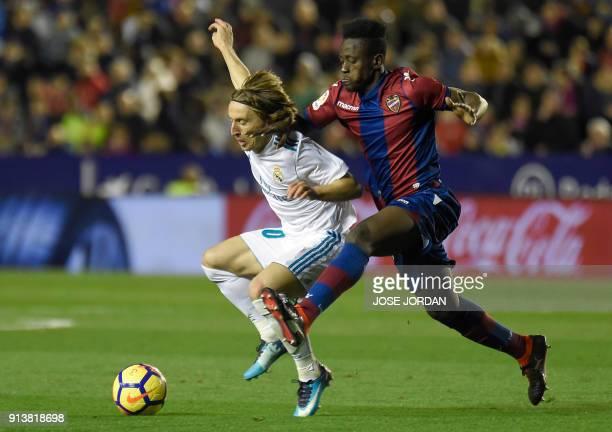 Real Madrid's Croatian midfielder Luka Modric vies with Levante's Ghanaian forward Emmanuel Boateng during the Spanish league football match between...