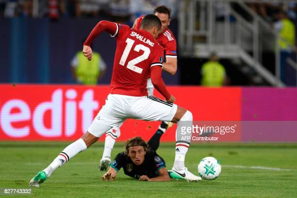 Real Madrid's Croatian midfielder Luka Modric vies with Manchester United's English defender Chris Smalling during the UEFA Super Cup football match...