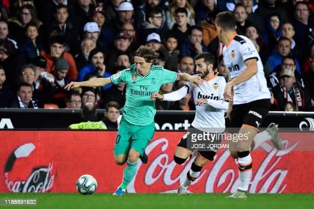 Real Madrid's Croatian midfielder Luka Modric vies with Valencia's Spanish defender Jose Luis Gaya Pena during the Spanish League football match...