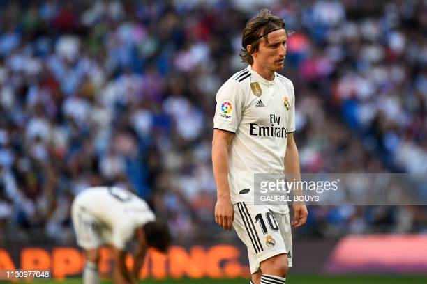 TOPSHOT Real Madrid's Croatian midfielder Luka Modric walks on the pitch during the Spanish league football match between Real Madrid CF and RC Celta...