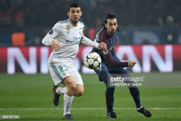 Real Madrid's Croatian midfielder Mateo Kovacic vies for the ball with Paris SaintGermain's Argentinian midfielder Javier Pastore during the UEFA...