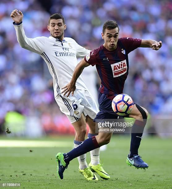 Real Madrid's Croatian midfielder Mateo Kovacic vies with Eibar's midfielder Escalante during the Spanish league football match Real Madrid CF vs SD...