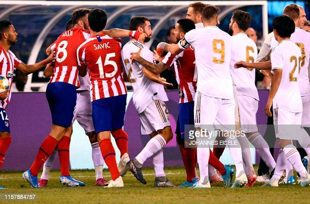 Real Madrid's Dani Carvajal brawls with players from Atletico during the 2019 International Champions Cup football match between Real Madrid and...