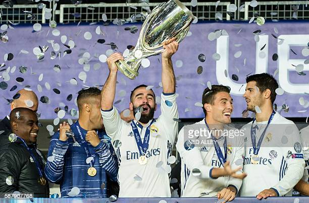 Real Madrid's Dani Carvajal celebrates with the trophy after winning the UEFA Super Cup final football match between Real Madrid CF and Sevilla FC on...