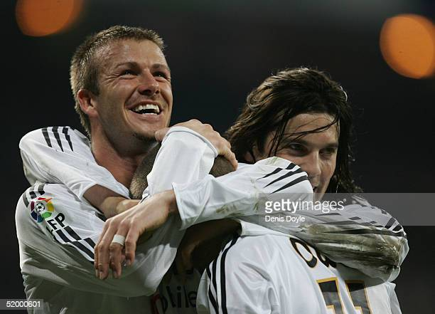 Real Madrids David Beckham and Santiago Solari congratulate Michael Owen after he scored a goal against Zaragoza during the Primera Liga soccer match...