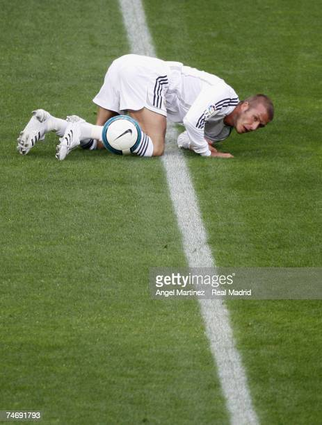 Real Madrid's David Beckham falls during the La Liga match between Real Madrid and Mallorca at the Santiago Bernabeu stadium on June 17 2007 in...