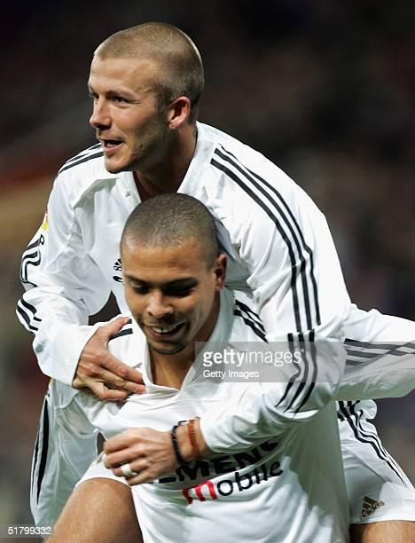 Real Madrids David Beckham jumps on top of Ronaldo after Ronaldo's goal against Levante during their la Liga match at the Bernabeu November 28 in...