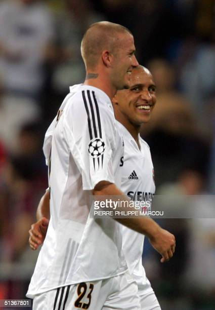 Real Madrid's David Beckham leaves the field flanked by Brazilian Roberto Carlos after winning their Group B European Champions League football match...