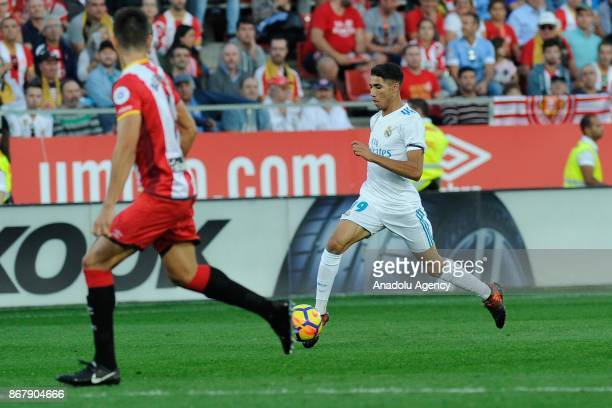 Real Madrid's defender Achraf Hakimi in action during the Spanish La Liga football match Girona FC vs Real Madrid CF at the Municipal de Montilivi...