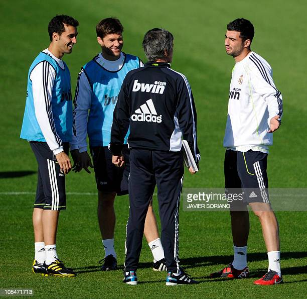 Real Madrid's defender Alvaro Arbeloa midfielder Xabi Alonso Portuguese coach Jose Mourinho and defender Raul Albiol chat as they take part in a...
