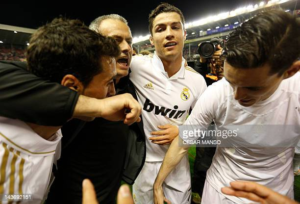 Real Madrid's defender Alvaro Arbeloa Real Madrid's Portuguese coach Jose Mourinho Real Madrid's Portuguese forward Cristiano Ronaldo and Real...