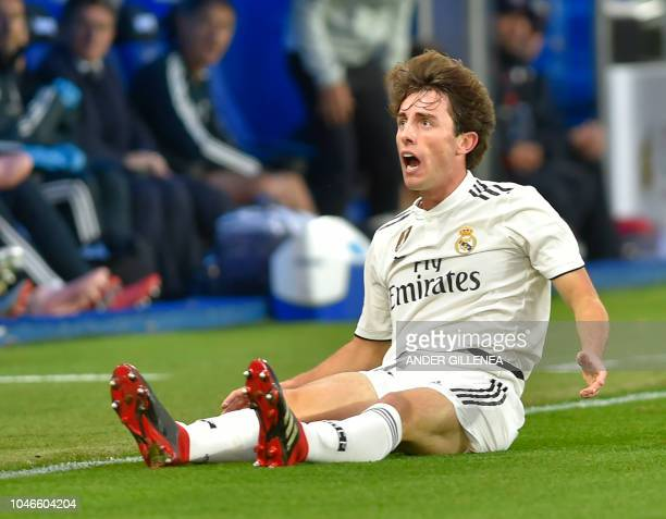 Real Madrid's defender Alvaro Odriozola sits on the ground during the Spanish league football match between Deportivo Alaves and Real Madrid CF at...