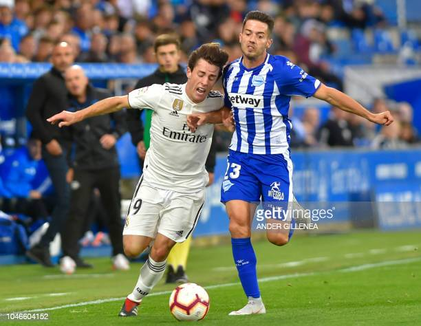 Real Madrid's defender Alvaro Odriozola vies with Alaves' Spanish defender Ruben Duarte during the Spanish league football match between Deportivo...