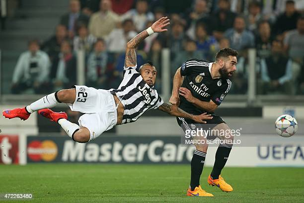 Real Madrid's defender Dani Carvajal fights for the ball with Juventus' midfielder from Chile Arturo Vidal during the UEFA Champions League semifinal...