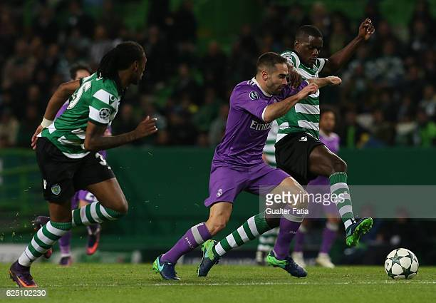 Real Madrid's defender Dani Carvajal from Spain with Sporting CP's midfielder William Carvalho and Sporting CP's defender Ruben Semedo in action...