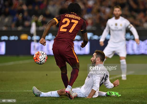Real Madrid's defender Dani Carvajal vies for the ball with AS Roma's forward Gervinho during the International Champions Cup football match between...
