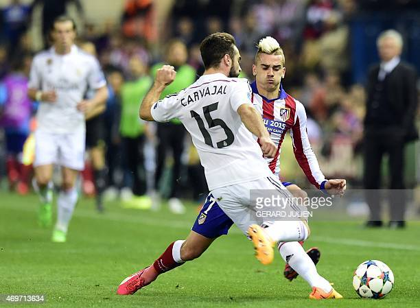 Real Madrid's defender Dani Carvajal vies with Atletico Madrid's French forward Antoine Griezmann during the UEFA Champions League quarter final...