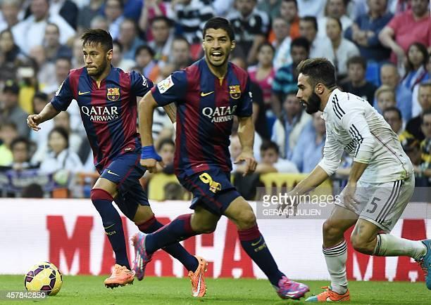 Real Madrid's defender Dani Carvajal vies with Barcelona's Brazilian forward Neymar da Silva Santos Junior and Barcelona's Uruguayan forward Luis...