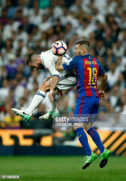 Real Madrid's defender Dani Carvajal vies with Barcelona's defender Jordi Alba during the Spanish league Clasico football match Real Madrid CF vs FC...