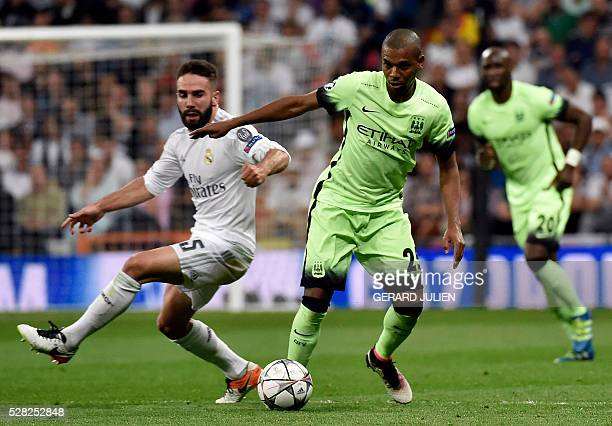 Real Madrid's defender Dani Carvajal vies with Manchester City's Brazilian midfielder Fernandinho during the UEFA Champions League semi-final second...