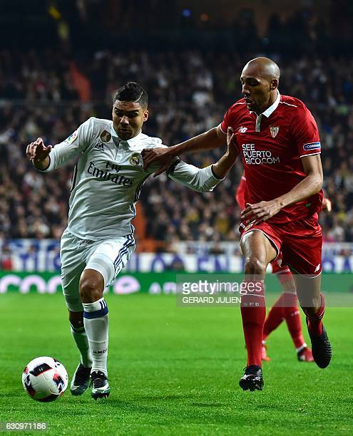 Real Madrid's defender Dani Carvajal vies with Sevilla's French midfielder Steven N'Zonzi during the Spanish Copa del Rey round of 16 first leg...
