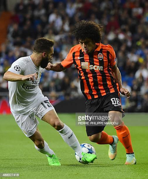 Real Madrid's defender Dani Carvajal vies with Shakhtar Donetsk's defender Azevedo during the UEFA Champions League group A football match Real...
