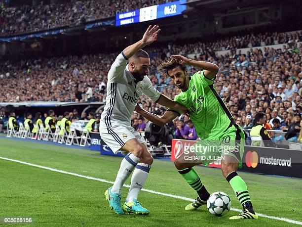 Real Madrid's defender Dani Carvajal vies with Sporting's Costa Rican forward Bryan Ruiz the UEFA Champions League football match Real Madrid CF vs...