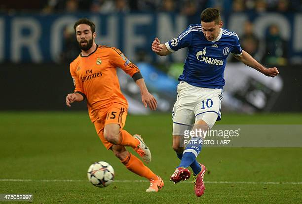 Real Madrid's defender Daniel Carvajal and Schalke's midfielder Julian Draxler vie for the ball during the firstleg round of 16 UEFA Champions League...