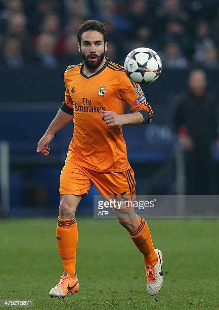 Real Madrid's defender Daniel Carvajal eyes the ball during the firstleg round of 16 UEFA Champions League football match Schalke 04 vs Real Madrid...