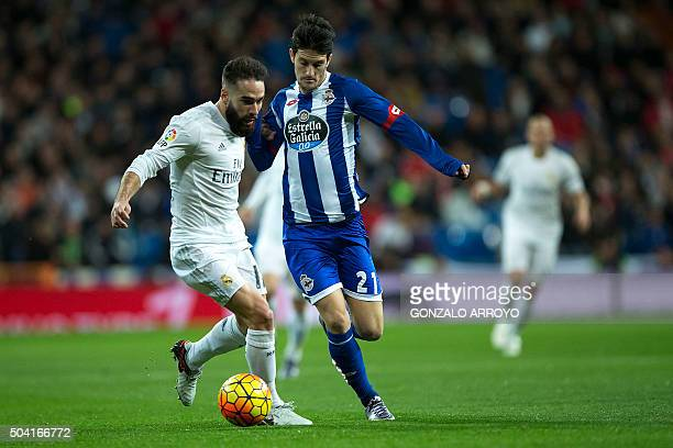 Real Madrid's defender Daniel Carvajal vies with Deportivo La Coruna's forward Luis Alberto Romero during the Spanish league football match Real...