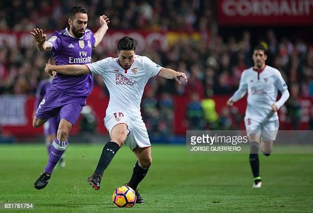 Real Madrid's defender Daniel Carvajal vies with Sevilla's French forward Samir Nasri during the Spanish league football match Sevilla FC vs Real...