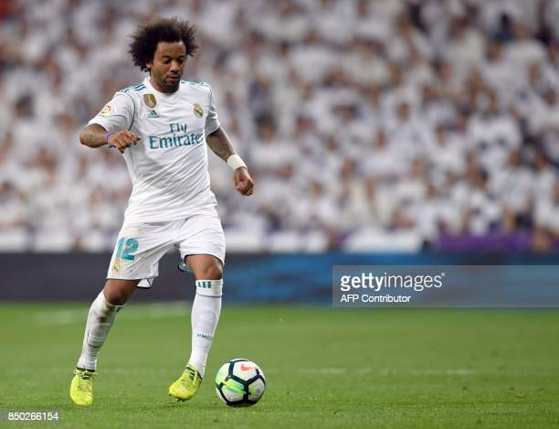 Real Madrid's defender from Brazil Marcelo controls the ball during the Spanish league football match Real Madrid CF against Real Betis at the...