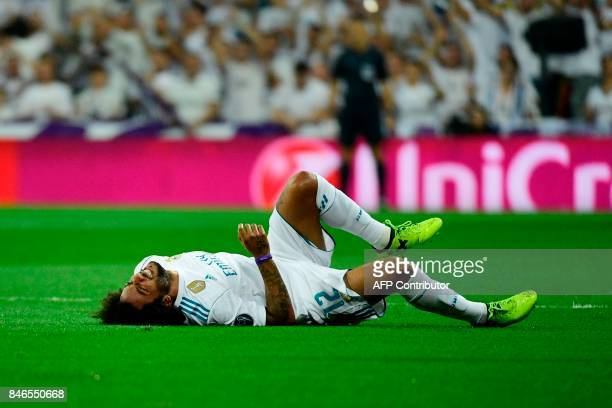 Real Madrid's defender from Brazil Marcelo gestures as he lies on the pitch during the UEFA Champions League football match Real Madrid CF vs APOEL...