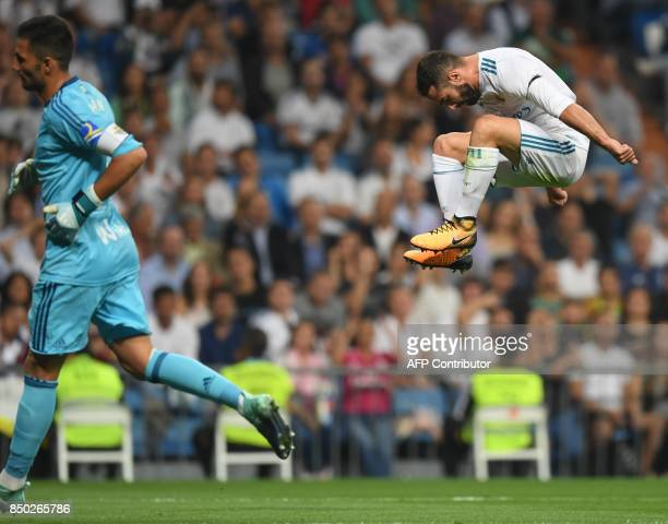 Real Madrid's defender from Spain Dani Carvajal jumps during the Spanish league football match Real Madrid CF against Real Betis at the Santiago...