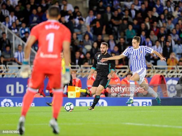 Real Madrid's defender from Spain Dani Carvajal vies with Real Real Sociedad's midfielder from Belgium Adnan Januzaj during the Spanish league...