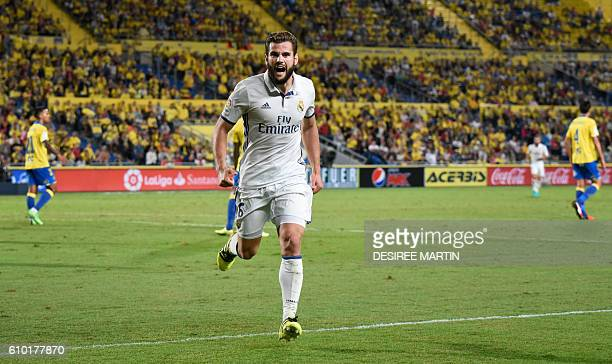 Real Madrid's defender Nacho Fernandez celebrates his teammate Alvaro Morata's goal during the Spanish league football match UD Las Palmas vs Real...