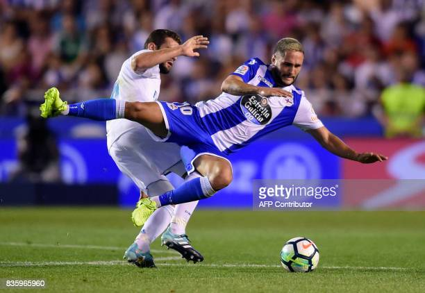 Real Madrid's defender Nacho Fernandez vies with Deportivo La Coruna's Romanian forward Florin Andone during the Spanish league footbal match RC...