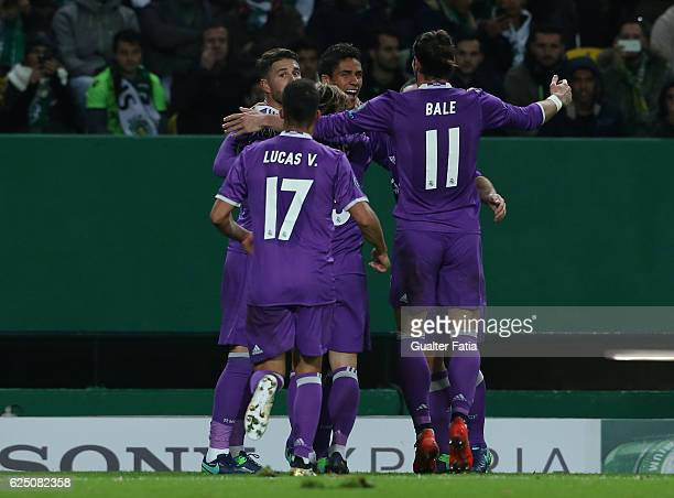 Real MadridÕs defender Raphael Varane from France celebrates with teammates after scoring a goal during the UEFA Champions League match between...