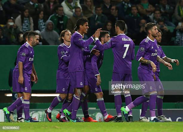 Real Madrid's defender Raphael Varane from France celebrates with teammates after scoring a goal during the UEFA Champions League match between...
