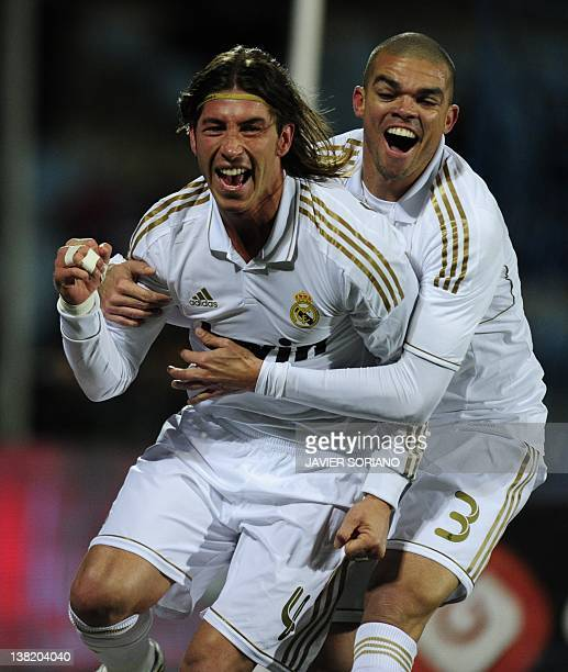 Real Madrid's defender Sergio Ramos and Real Madrid's Portuguese defender Pepe celebrate after scoring their first goal during their Spanish league...